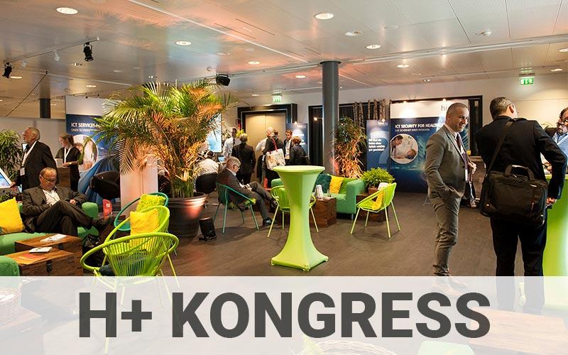 H+ Kongress, Businessleute sprechen miteinander bei einem Meeting